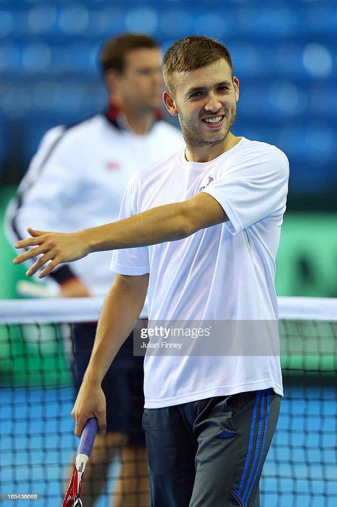 Daniel Evans of Great Britain smiles in a practice session during previews for the Davis Cup match between Great Britain and Russia at the Ricoh Arena on April 4, 2013 in Coventry, England.