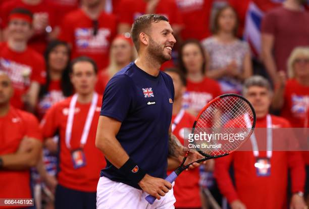 Daniel Evans of Great Britain smiles in his singles match against Julien Benneteau of France during day 3 of the Davis Cup World Group QuarterFinal...