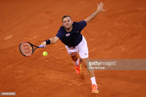 Daniel Evans of Great Britain stretches to hit a forehand during the singles match against Jeremy Chardy of France on day one of the Davis Cup World...