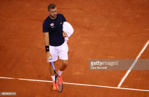 Daniel Evans of Great Britain throws his racquet during the singles match against Jeremy Chardy of France on day one of the Davis Cup World Group...