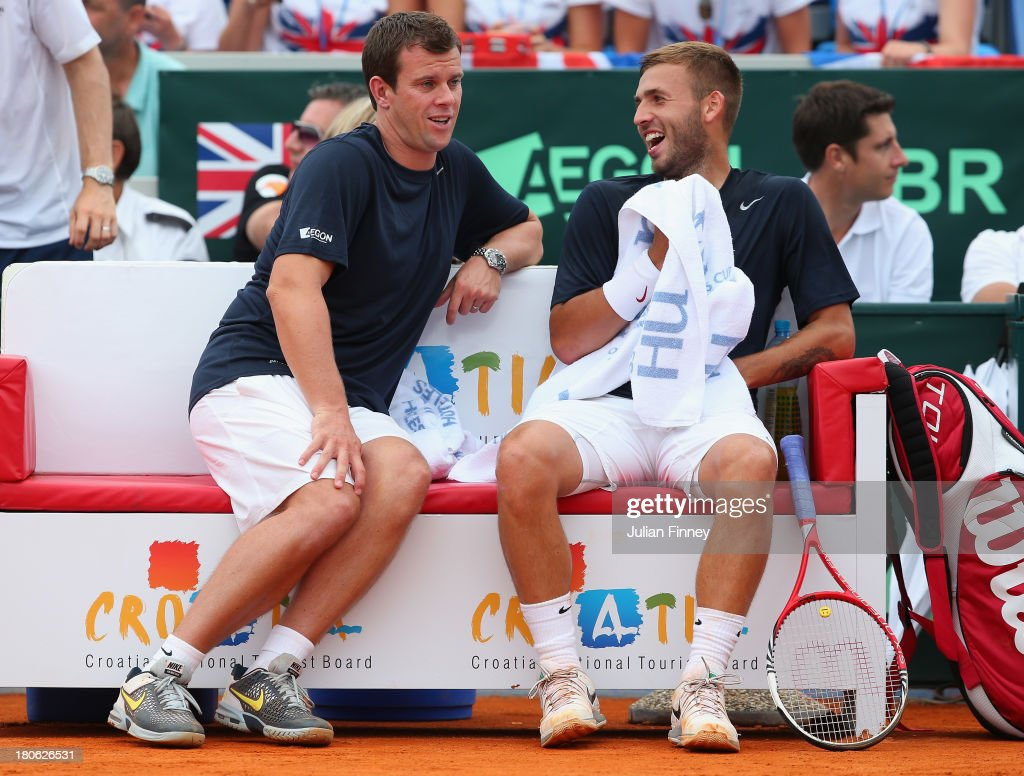 Daniel Evans of Great Britain with captain <a gi-track='captionPersonalityLinkClicked' href=/galleries/search?phrase=Leon+Smith+-+Tennis+Coach&family=editorial&specificpeople=12698515 ng-click='$event.stopPropagation()'>Leon Smith</a> in his match against Mate Pavic of Croatia during day three of the Davis Cup World Group play-off tie between Croatia and Great Britain at Stadion Stella Maris on September 15, 2013 in Umag, Croatia.