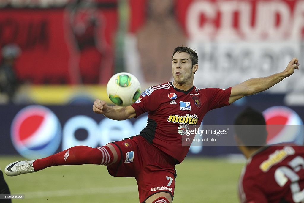 Daniel Febles of Caracas FC fights for the ball during a match between Caracas FC and Deportivo Tachira as part of the Torneo Clausura 2013 at Olympic stadium on May 12, 2013 in Caracas, Venezuela.