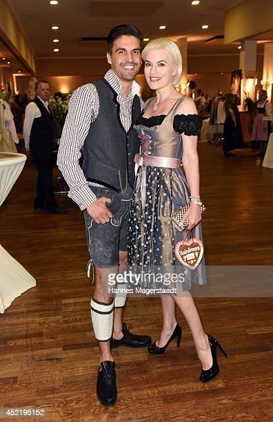 Daniel Fendler and Kriemhild Siegel attend the Sixt ladies dirndl dinner on July 15 2014 in Munich Germany