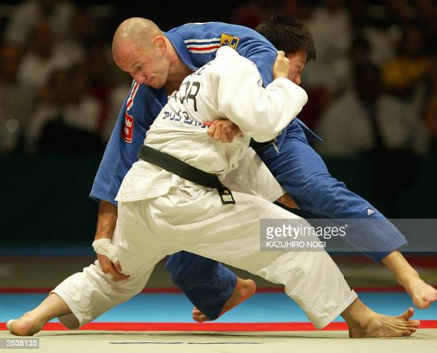 Daniel Fernandes of France fights with South Korean Lee WonHee during men's under 73 kg class final match at the World Judo Championships in Osaka 13...