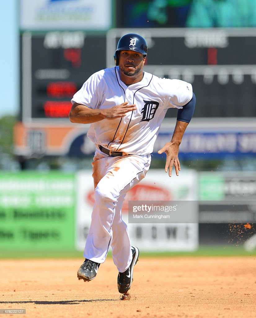Daniel Fields #34 of the Detroit Tigers runs the bases during the spring training game against the New York Mets at Joker Marchant Stadium on March 8, 2014 in Lakeland, Florida. The Mets defeated the Tigers 3-2.