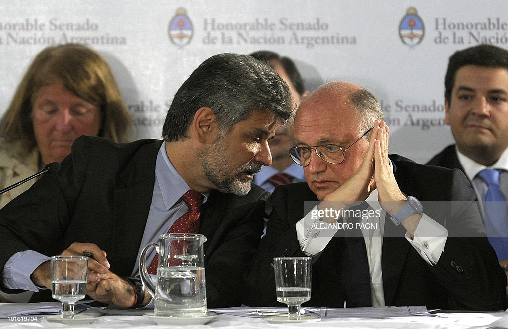 Daniel Filmus (L), deputy for the ruling party, talks with Argentine Foreign Minister Hector Timerman during a Senate session to discuss the agreement signed with Iran concerning the investigation of the bombing attack against the Jewish organization AMIA, in Buenos Aires, on February 13, 2013. Iran denied Tuesday that Iranians facing international arrest warrants for their alleged roles in the 1994 bombing of a Buenos Aires Jewish centre will be questioned by an Argentinian judge, as announced by Argentine's foreign minister.