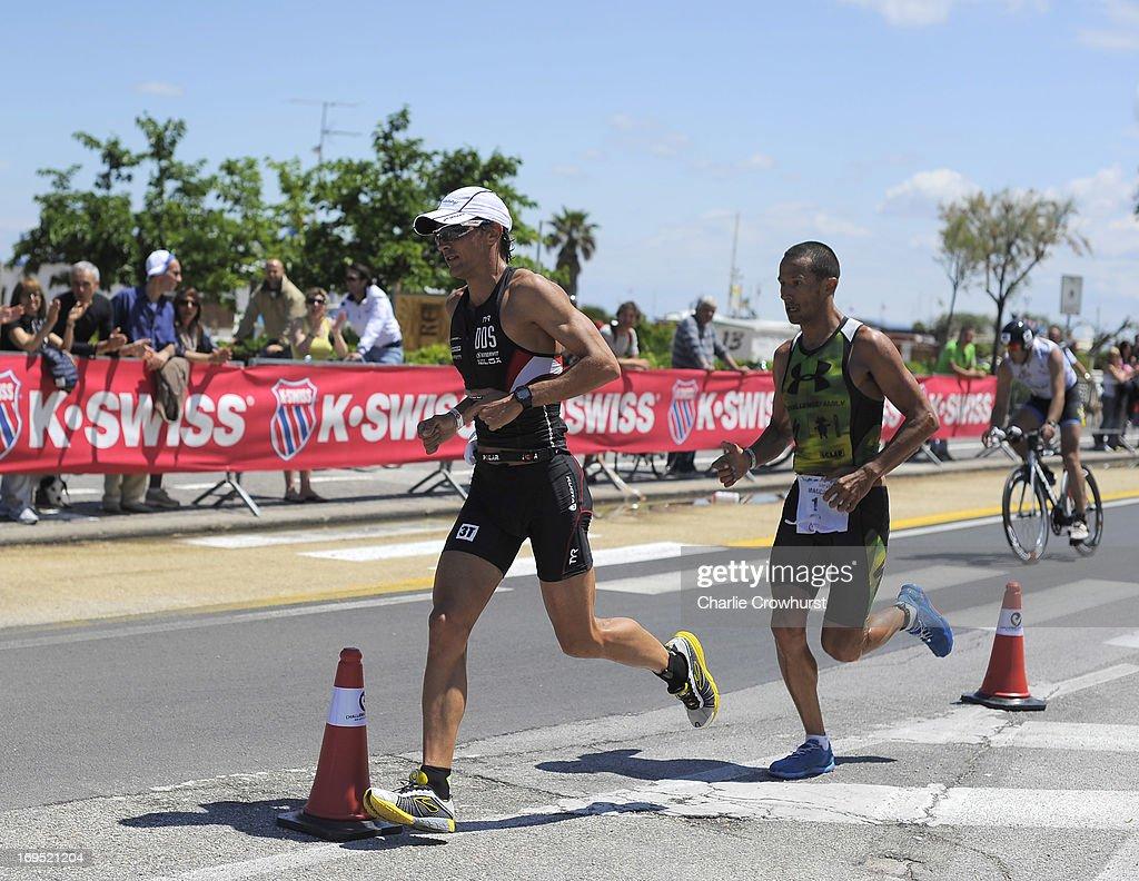 Daniel Fontana of Italy leads Australia's Chris McCormack during the Challenge Family Triathlon Rimini on May 26, 2013 in Rimini, Italy.