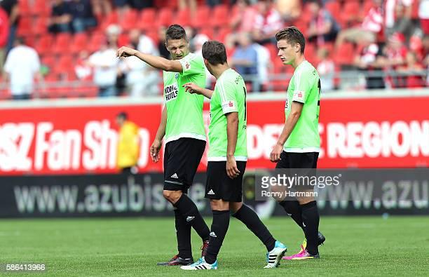 Daniel Frahn Anton Fink and Florian Hansch of Chemnitz leave the pitch after the Third League match between Hallescher FC and Chemnitzer FC at...
