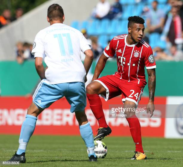 Daniel Frahn of Chemnitz and Corentin Tolisso of Bayern Muenchen battle for the ball during the DFB Cup first round match between Chemnitzer FC and...