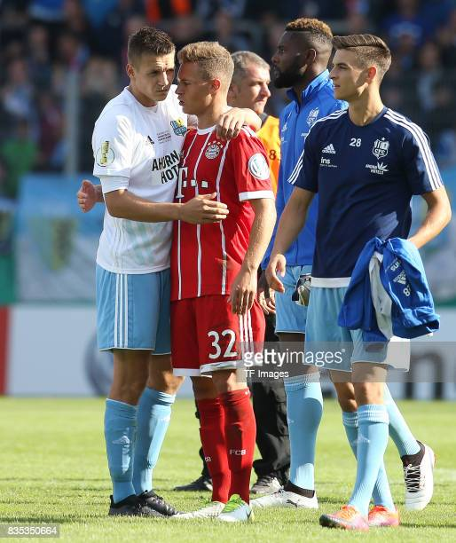 Daniel Frahn of Chemnitz and Joshua Kimmich of Bayern Muenchen looks on during the DFB Cup first round match between Chemnitzer FC and FC Bayern...