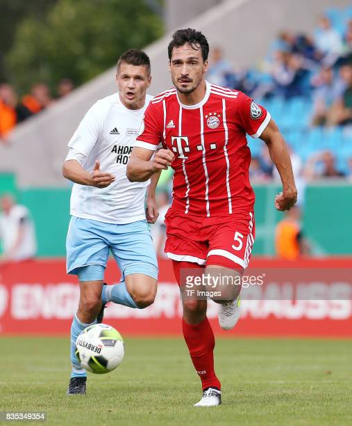 Daniel Frahn of Chemnitz and Mats Hummels of Bayern Muenchen controls the ball during the DFB Cup first round match between Chemnitzer FC and FC...