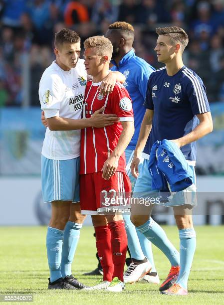 Daniel Frahn of Chemnitz mit Joshua Kimmich of Bayern Muenchen looks on during the DFB Cup first round match between Chemnitzer FC and FC Bayern...