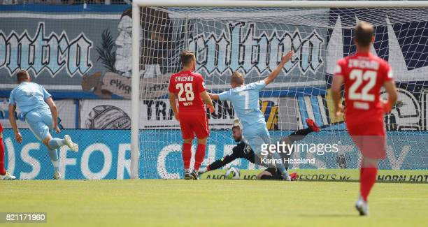 Daniel Frahn of Chemnitz scores the opening goal Goalkeeper Johannes Brinkies of Zwickau without a chance during the 3Liga match between Chemnitzer...