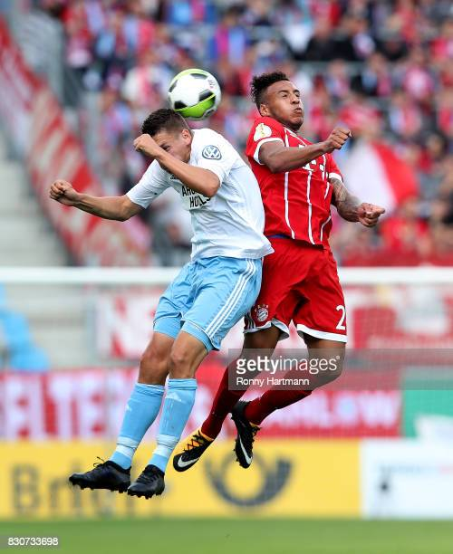 Daniel Frahn of Cottbus heads for the ball with Corentin Tolisso of Muenchen during the DFB Cup first round match between Chemnitzer FC and FC Bayern...