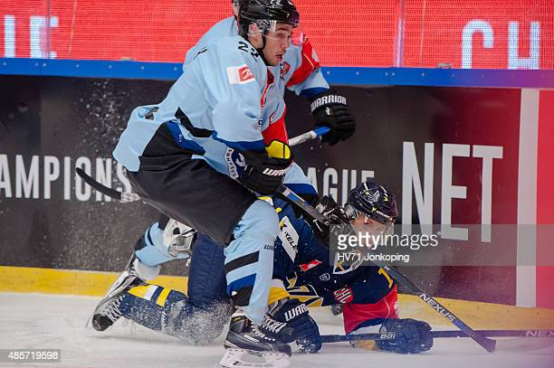 Daniel Galbraith of Soderjyske tackles Martin Thornberg of HV71 during the Champions Hockey League group stage game between HV71 Jonkoping and...