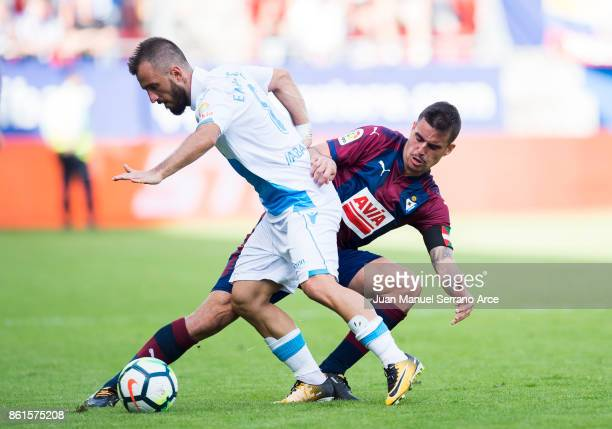 Daniel Garcia of SD Eibar duels for the ball with Emre Colak of RC Deportivo La Coruna during the La Liga match between SD Eibar and RC Deportivo La...