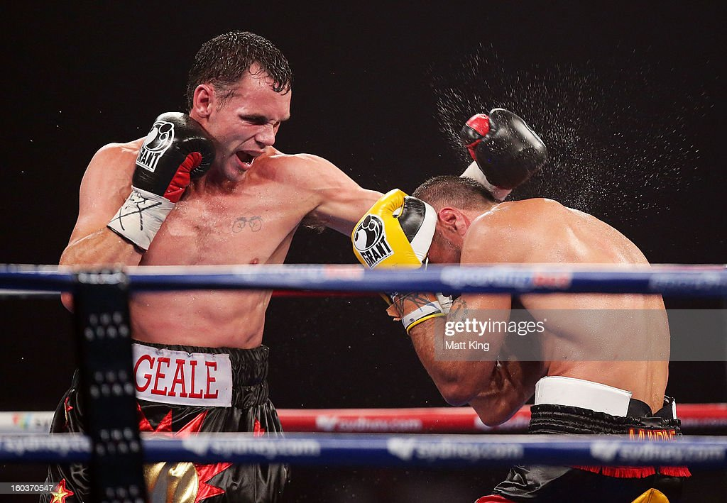 Daniel Geale (R) lands a left on Anthony Mundine (L) during the IBF Middleweight Title bout between Anthony Mundine and Daniel Geale at Sydney Entertainment Centre on January 30, 2013 in Sydney, Australia.
