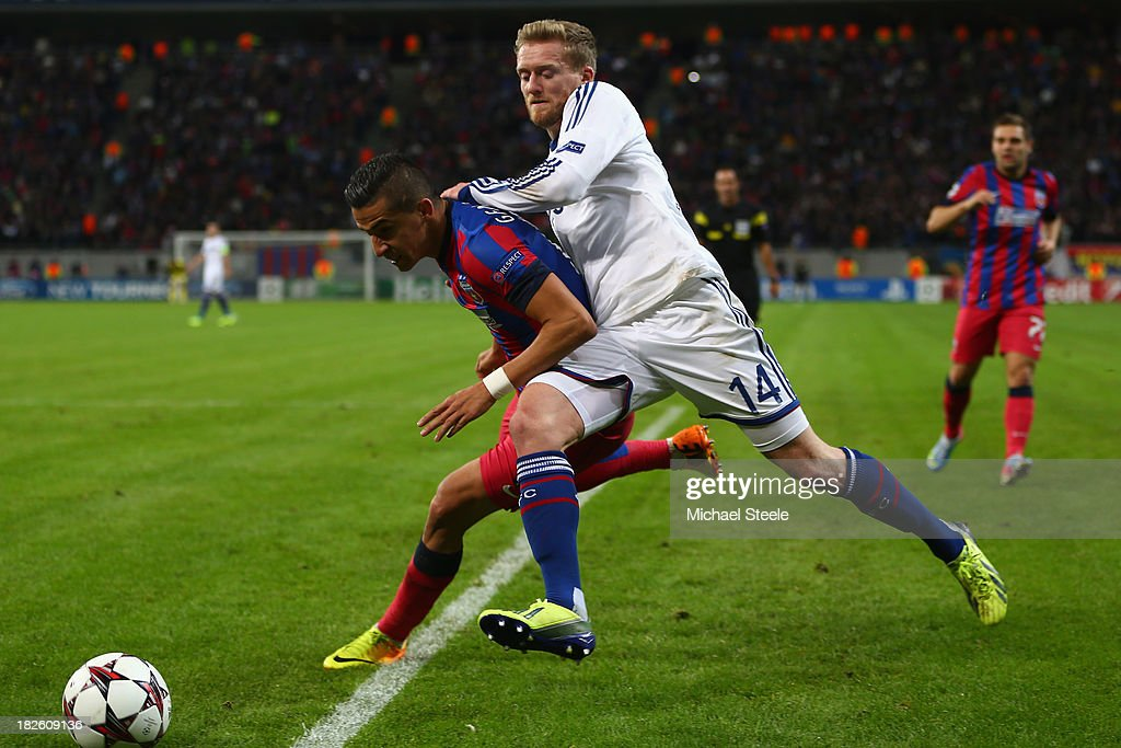 Daniel Georgievski (L) of Steaua Bucuresti is challenged by Andre Schurrle (R) of Chelsea during the UEFA Champions League Group E Match between FC Steaua Bucuresti and Chelsea at the National Arena Stadium on October 1, 2013 in Bucharest, Romania.
