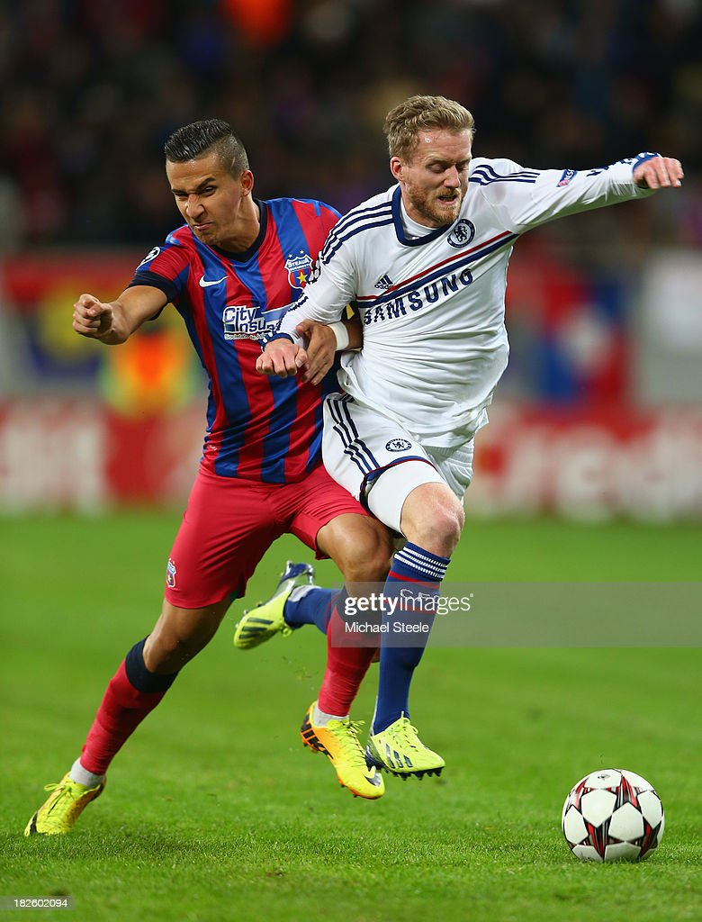 Daniel Georgievski (L) of Steaua Bucuresti loses out to Andre Schurrle (R) of Chelsea during the UEFA Champions League Group E Match between FC Steaua Bucuresti and Chelsea at the National Arena Stadium on October 1, 2013 in Bucharest, Romania.