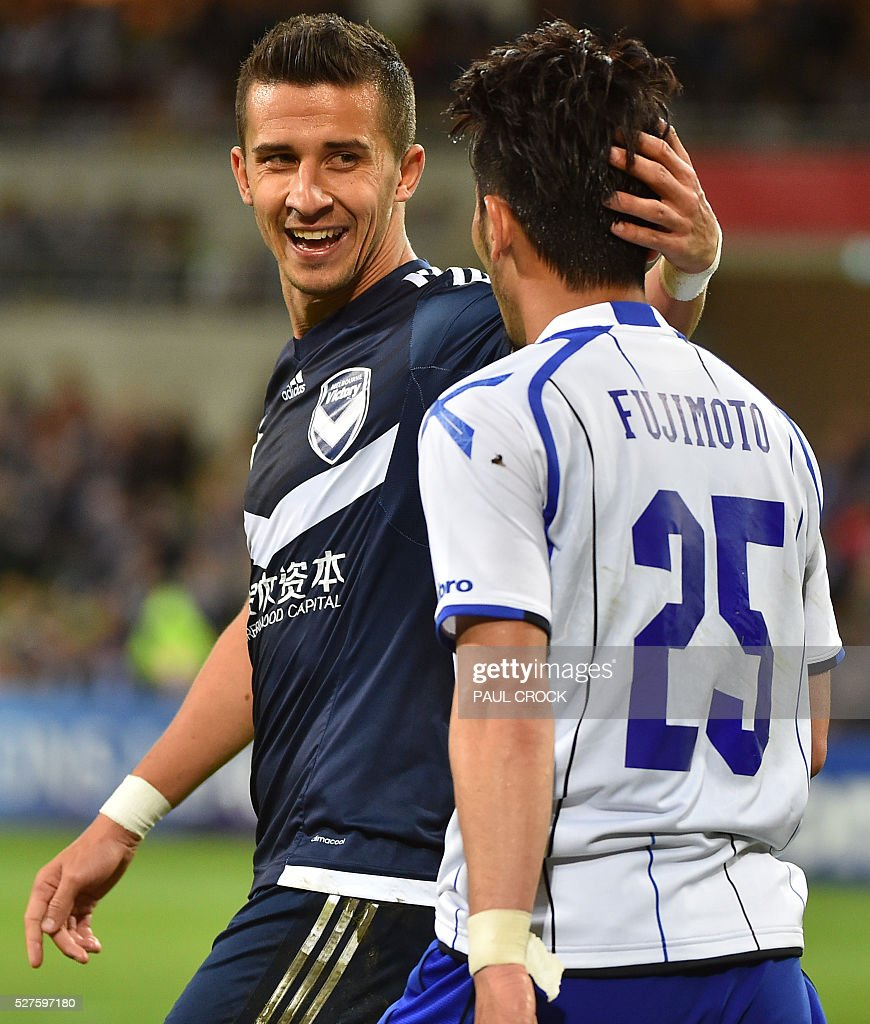 Daniel Gerogievski (L) of Melbourne Victory gestures with Jungo Fujimoto of Gamba Osaka during the AFC Champions League football match between Melbourne Victory and Gamba Osaka in Melbourne on May 3, 2016. / AFP / Paul Crock / IMAGE