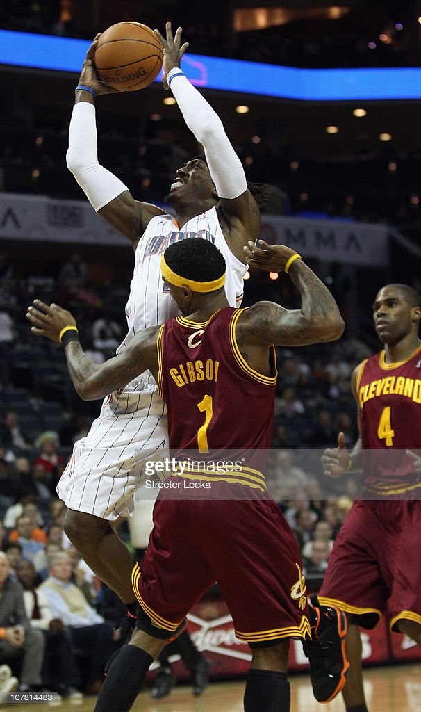 <a gi-track='captionPersonalityLinkClicked' href=/galleries/search?phrase=Daniel+Gibson&family=editorial&specificpeople=213906 ng-click='$event.stopPropagation()'>Daniel Gibson</a> #1 of the Cleveland Cavaliers backs away from <a gi-track='captionPersonalityLinkClicked' href=/galleries/search?phrase=Gerald+Wallace&family=editorial&specificpeople=202117 ng-click='$event.stopPropagation()'>Gerald Wallace</a> #3 of the Charlotte Bobcats during their game at Time Warner Cable Arena on December 29, 2010 in Charlotte, North Carolina.