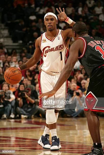 Daniel Gibson of the Cleveland Cavaliers calls out the play while defended by Lindsey Hunter of the Chicago Bulls on December 4 2009 at The Quicken...