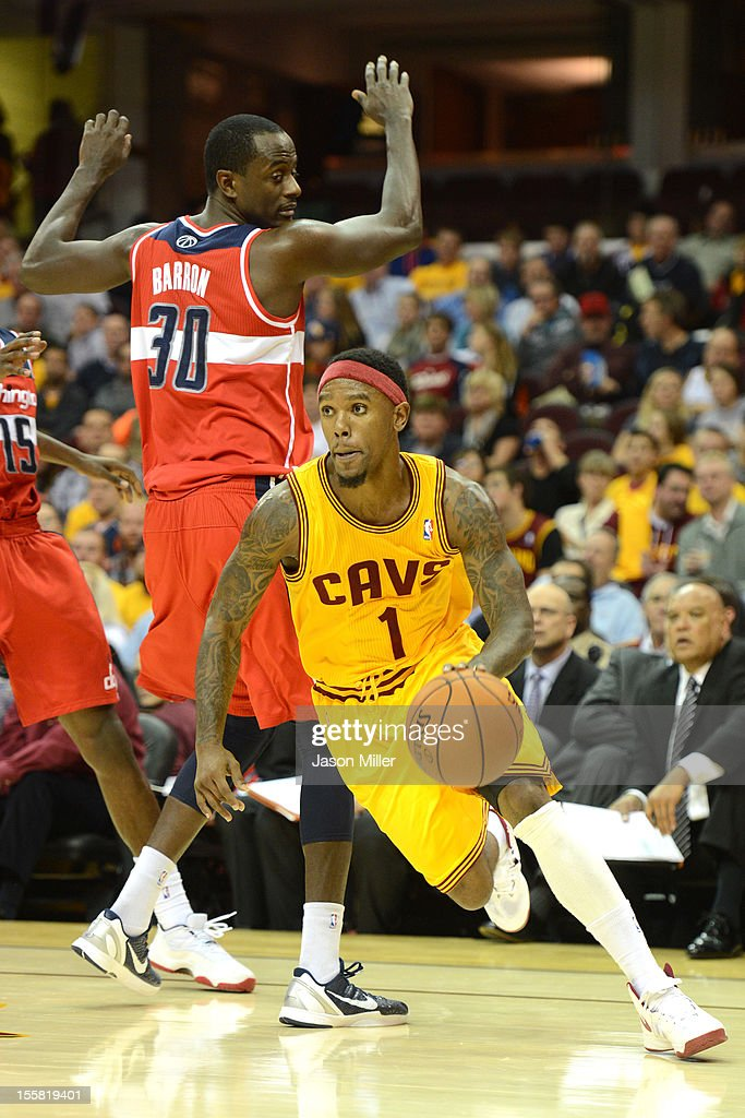 Daniel Gibson #1 of the Cleveland Cavaliers drives past Earl Barron #30 of the Washington Wizards during the game against the Washington Wizards at Quicken Loans Arena on October 30, 2012 in Cleveland, Ohio. The Cavaliers defeated the Wizards 94-84.