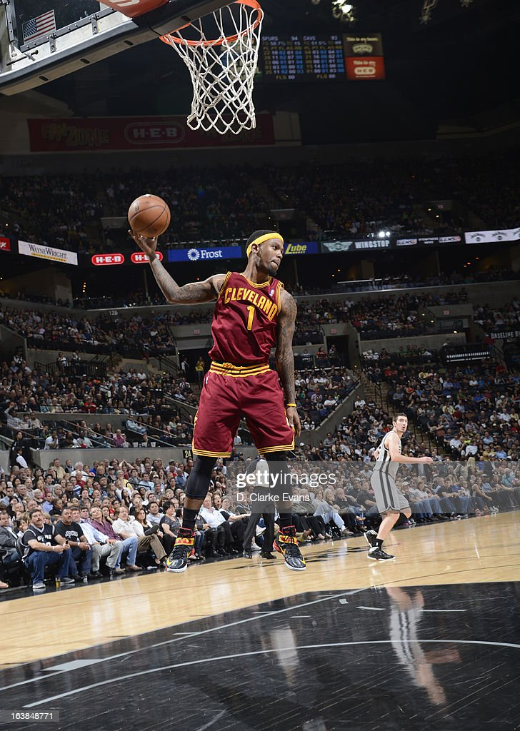 Daniel Gibson #1 of the Cleveland Cavaliers grabs a rebound during the game between the Cleveland Cavaliers and the San Antonio Spurs on March 16, 2013 at the AT&T Center in San Antonio, Texas.