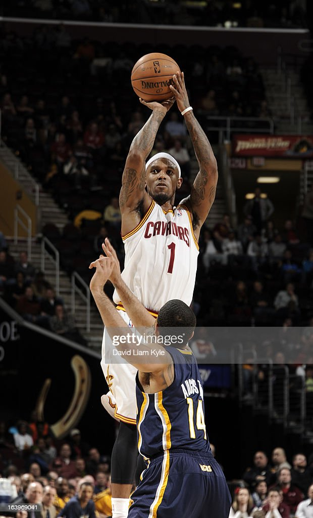 Daniel Gibson #1 of the Cleveland Cavaliers shoots against D.J. Augustin #14 of the Indiana Pacers at The Quicken Loans Arena on March 18, 2013 in Cleveland, Ohio.