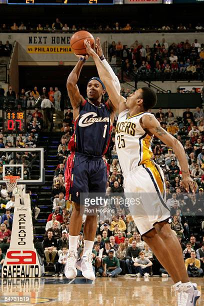 Daniel Gibson of the Cleveland Cavaliers shoots over Brandon Rush of the Indiana Pacers at Conseco Fieldhouse on February 10 2009 in Indianapolis...