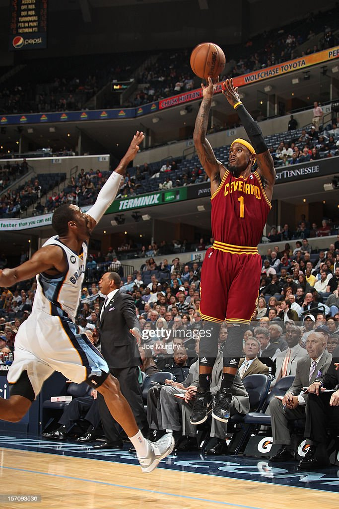 <a gi-track='captionPersonalityLinkClicked' href=/galleries/search?phrase=Daniel+Gibson&family=editorial&specificpeople=213906 ng-click='$event.stopPropagation()'>Daniel Gibson</a> #1 of the Cleveland Cavaliers shoots the ball against <a gi-track='captionPersonalityLinkClicked' href=/galleries/search?phrase=Wayne+Ellington&family=editorial&specificpeople=2351537 ng-click='$event.stopPropagation()'>Wayne Ellington</a> #3 of the Memphis Grizzlies on November 26, 2012 at FedExForum in Memphis, Tennessee.