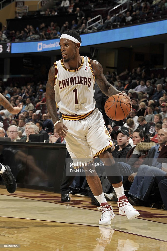 <a gi-track='captionPersonalityLinkClicked' href=/galleries/search?phrase=Daniel+Gibson&family=editorial&specificpeople=213906 ng-click='$event.stopPropagation()'>Daniel Gibson</a> #1 of the Cleveland Cavaliers surveys the defense against the Montepaschi Siena at The Quicken Loans Arena on October 8, 2012 in Cleveland, Ohio.