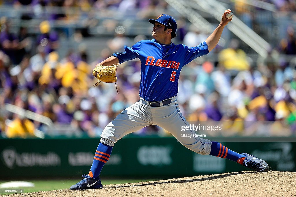 <a gi-track='captionPersonalityLinkClicked' href=/galleries/search?phrase=Daniel+Gibson&family=editorial&specificpeople=213906 ng-click='$event.stopPropagation()'>Daniel Gibson</a> #6 of the Florida Gators throws a pitch against the LSU Tigers during a game at Alex Box Stadium on May 4, 2013 in Baton Rouge, Louisiana.