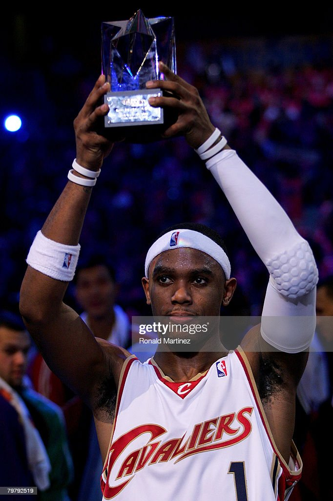 Daniel Gibson of the Sophomore holds up the MVP trophy following the Sophomores' win over the Rookies during the TMobile Rookie Challenge Youth Jam...