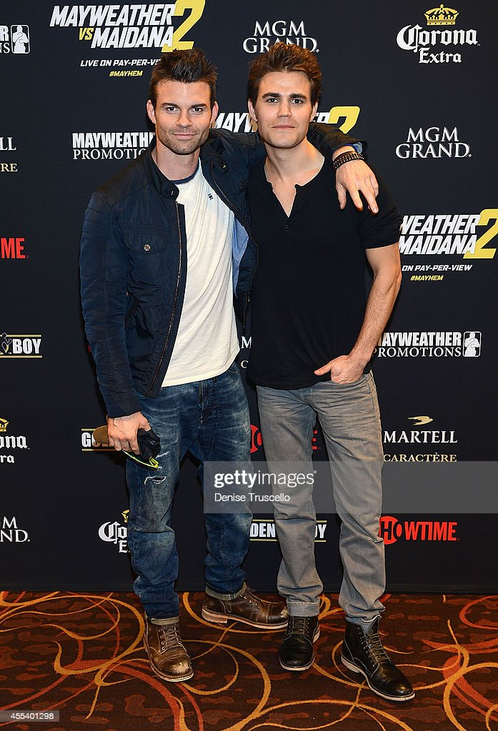 <a gi-track='captionPersonalityLinkClicked' href=/galleries/search?phrase=Daniel+Gillies&family=editorial&specificpeople=675058 ng-click='$event.stopPropagation()'>Daniel Gillies</a> and <a gi-track='captionPersonalityLinkClicked' href=/galleries/search?phrase=Paul+Wesley&family=editorial&specificpeople=693176 ng-click='$event.stopPropagation()'>Paul Wesley</a> arrive at Showtime's VIP Pre-Fight party for 'MAYHEM: MAYWEATHER VS. MAIDANA 2' at MGM Grand Garden Arena on September 13, 2014 in Las Vegas, Nevada.