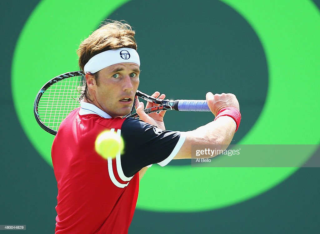 Daniel Gimeno Traver of Spain returns a shot to Stanislas Wawrinka of Switzerland Daniel Gimeno Traver of Spain during their match on day 6 of the Sony Open at Crandon Park Tennis Center on March 22, 2014 in Key Biscayne, Florida.