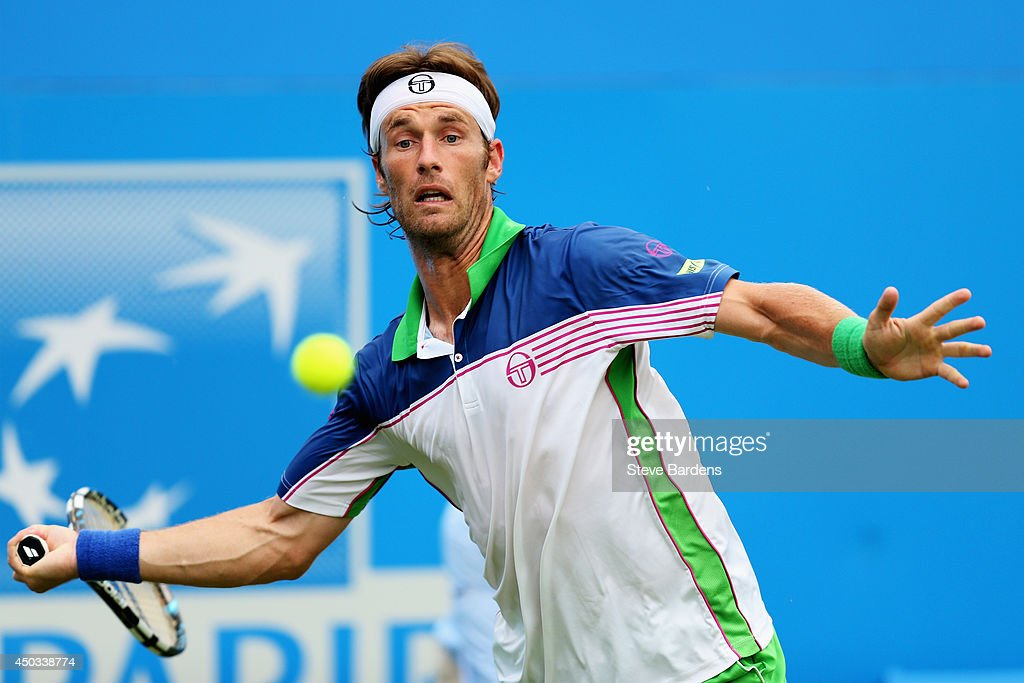 <a gi-track='captionPersonalityLinkClicked' href=/galleries/search?phrase=Daniel+Gimeno-Traver&family=editorial&specificpeople=553830 ng-click='$event.stopPropagation()'>Daniel Gimeno-Traver</a> of Spain plays a forehand in his match against Lleyton Hewitt of Australia during their Men's Singles match on day one of the Aegon Championships at Queens Club on June 9, 2014 in London, England.