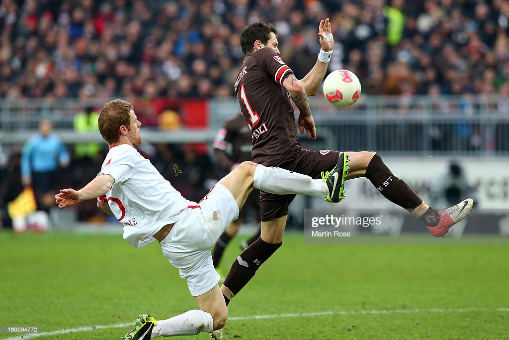 Daniel Ginczek (R) of St. Pauli and <a gi-track='captionPersonalityLinkClicked' href=/galleries/search?phrase=Uwe+Moehrle&family=editorial&specificpeople=653929 ng-click='$event.stopPropagation()'>Uwe Moehrle</a> (L) of Cottbus battle for the ball during the second Bundesliga match between FC St. Pauli and Energie Cottbus at Millerntor Stadium at Millerntor Stadium on February 3, 2013 in Hamburg, Germany.
