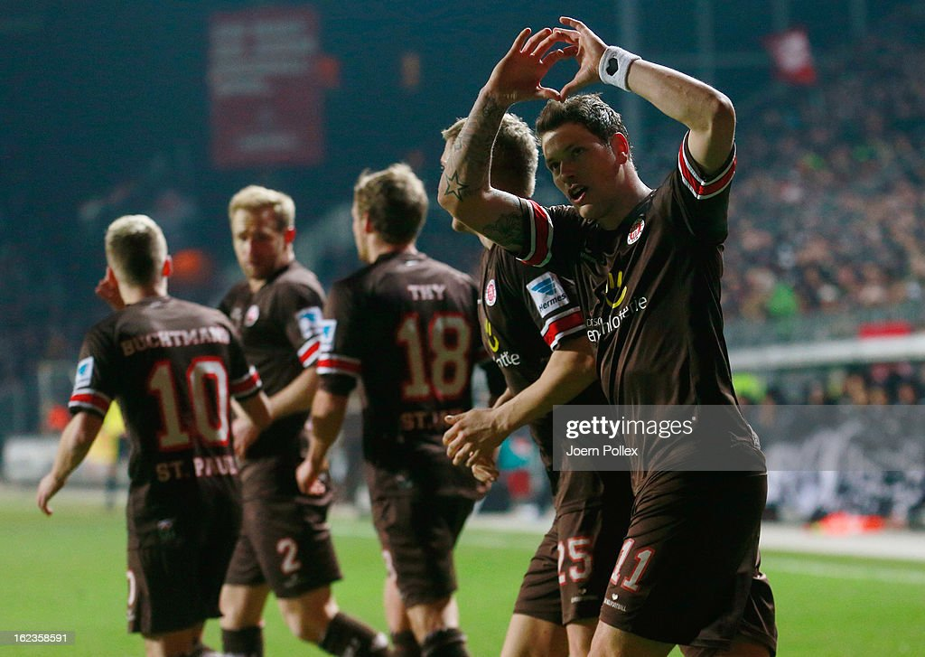 Daniel Ginczek (R) of St. Pauli celebrates after scoring the opening goal of the Second Bundesliga match between 1. FC St. Pauli and FSV Frankfurt 1899 at Millerntor Stadium on February 22, 2013 in Hamburg, Germany.