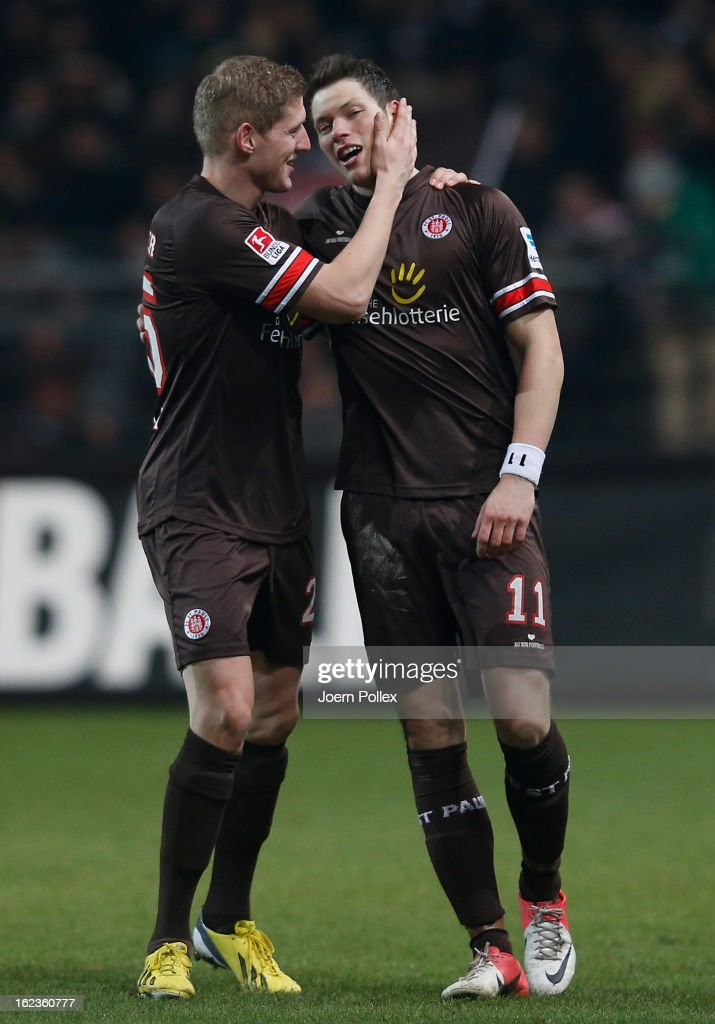 Daniel Ginczek (R) of St. Pauli is congratulated by team-mate <a gi-track='captionPersonalityLinkClicked' href=/galleries/search?phrase=Florian+Kringe&family=editorial&specificpeople=635000 ng-click='$event.stopPropagation()'>Florian Kringe</a> after scoring their team's second goal during the Second Bundesliga match between 1. FC St. Pauli and FSV Frankfurt 1899 at Millerntor Stadium on February 22, 2013 in Hamburg, Germany.