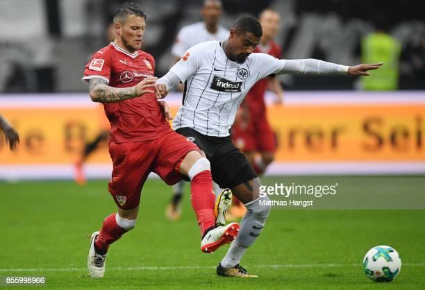 Daniel Ginczek of Stuttgart and KevinPrince Boateng of Frankfurt compete for the ball during the Bundesliga match between Eintracht Frankfurt and VfB...