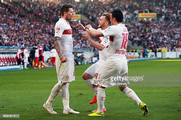 Daniel Ginczek of Stuttgart celebrates his team's second goal with team mates Alexandru Maxim and Filip Kostic during the Bundesliga match between...