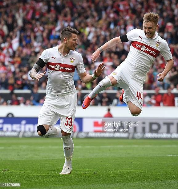Daniel Ginczek of Stuttgart celebrates with his teammate Alexandru Maxim of Stuttgart after scoring his team's first goal during the Bundesliga match...