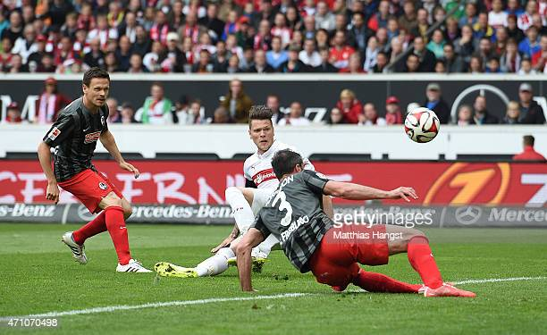 Daniel Ginczek of Stuttgart scores his team's first goal during the Bundesliga match between VfB Stuttgart and SC Freiburg at MercedesBenz Arena on...