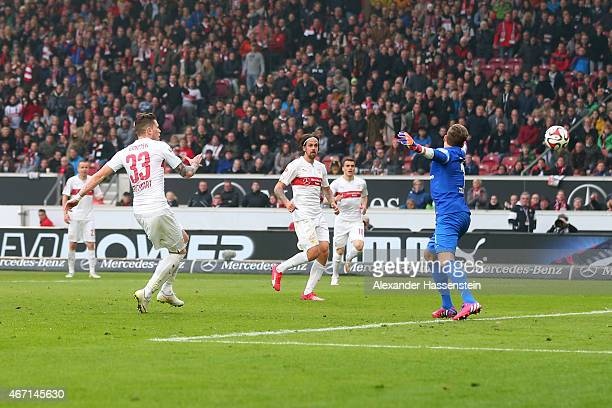Daniel Ginczek of Stuttgart scores the 2nd team goal against Kevin Trapp keeper of Frankfurt during the Bundesliga match between VfB Stuttgart and...