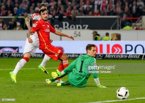 Daniel Ginczek of Stuttgart scores the third goal for his team against Daniel Mesenhoeler of Berlin during the Second Bundesliga match between VfB...