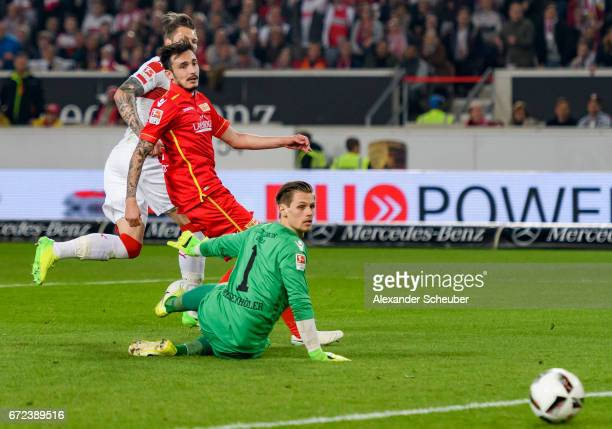Daniel Ginczek of Stuttgart scores the third goal for his team against Daniel Mesenhoeler of Berlin during the Second Bundesliga match between VfB...