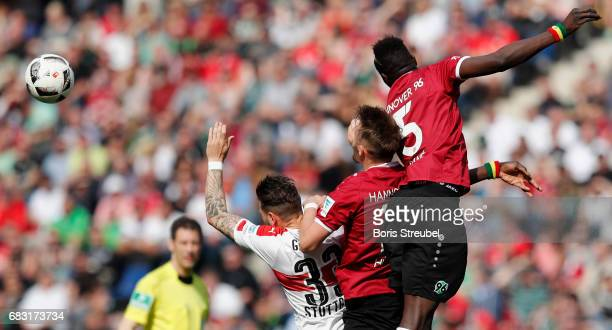 Daniel Ginczek of VfB Stuttgart jumps for a header with Martin Harnik and Salif Sane of Hannover 96 during the Second Bundesliga match between...