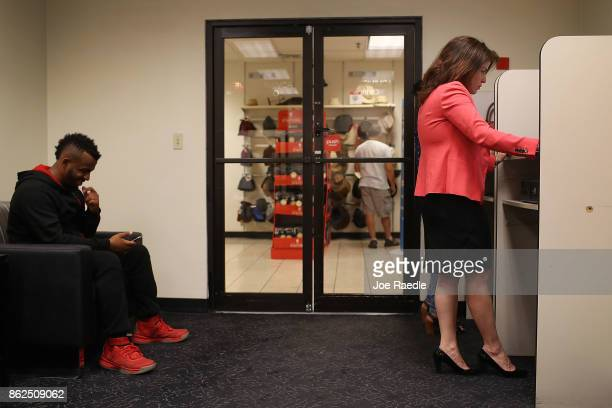 Daniel Gomez and Janice Montalvo wait to be interviewed for a seaonal job during a job fair at the JC Penny department store in the Dadeland Mall on...