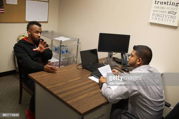 Daniel Gomez is interviewed by Steve Persaud a JC Penny Assistant Merchandise Manager for a seasonal job during a job fair at the JC Penny department...